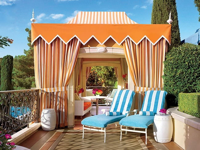 Lounge by the pool without sacrificing your privacy by renting a cabana, like this colorful number at Wynn.