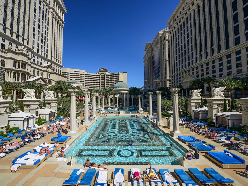 Vegas cabanas and pool parties to enjoy this summer for Garden of gods pool oasis
