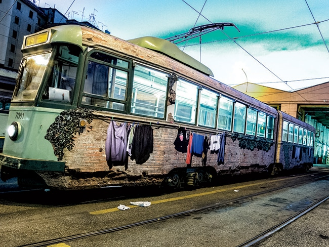 Sbagliato will adorn the city with his eerily lifelike work, like the clothing seemingly hanging from this train.